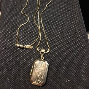 1928 gold tone locket